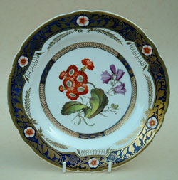 Typical hand painted flowers on a Bone China dessert plate