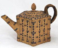 Caneware Teaport with blue ornamentation