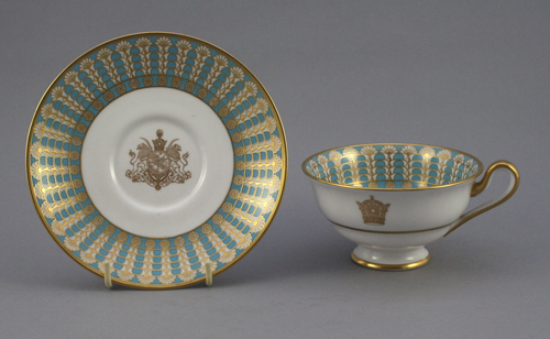 Bone china tea cup and saucer in turquoise with gold decoration