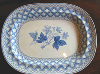 "An underglaze blue printed platter, c.1825 printed in the ""Geranium"" pattern."